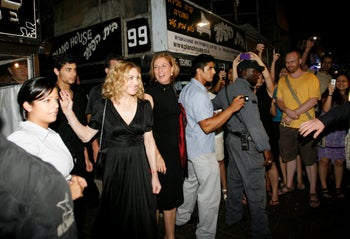 File photo: U.S. singer Madonna, third left, and then-Kadima party leader Tzipi Livni, fourth left, are seen outside a restaurant in Tel Aviv, Israel, Monday, Aug. 31, 2009.