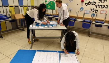 Israeli poll workers prepare a polling site on Election Day, April 9, 2019.