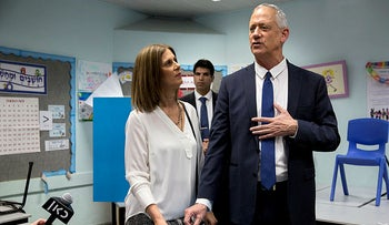 Blue and White party leader Benny Gantz, casts his vote with his wife Revital Gantz in Rosh Haayin, Israel, April 9, 2019.