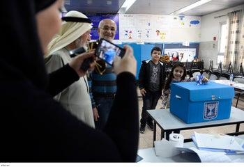 Residents cast their votes in the northern city of Taibeh.