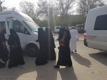 Israeli Bedouin women head to vote in a van rented for Election Day in the community of Segev Shalom