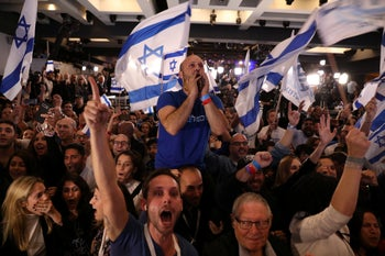 Kahol Lavan activists cheer as exit polls pour in at the party's headquarters, Israel, April 9, 2019.