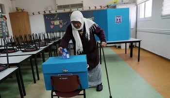 An Israeli-Arab woman casting her ballot as Israelis began voting in a parliamentary election, at a polling station in Haifa, Israel April 9, 2019.