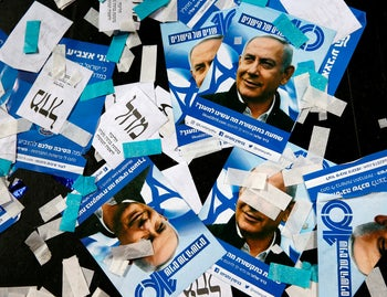 Israeli Likud Party campaign material and posters of Prime Minister Benjamin Netanyahu strown on the floor following election night at the party headquarters in Tel Aviv, April 10, 2019.