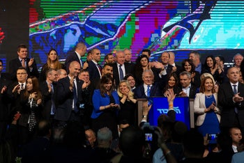 Likud party members on stage with Prime Minister Benjamin Netanyahu at the party headquarters in Tel Aviv, April 10, 2019.