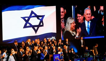 Israeli Prime Minister Benjamin Netanyahu waves to supporters at his Likud Party headquarters in Tel Aviv on election night early on April 10, 2019