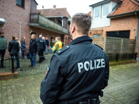 FILE PHOTO: A police officer attends a raid against fraud crime in Wriedel, Germany, on Wednesday, March 27, 2019.