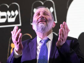 Arye Dery celebrates the election results at Shas headquarters, Jerusalem, April 9, 2019.