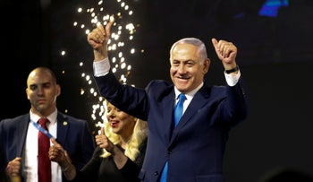 Prime Minister Benjamin Netanyahu waves to his supporters after polls for Israel's general elections closed in Tel Aviv, Israel, Wednesday, April 10, 2019.