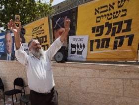 A Shas party member stands outside the polling stations in Be'er Sheva, April 9, 2019.