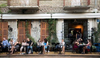 FILE Photo: Israelis sit outside a coffee shop on Rothschild Boulevard.