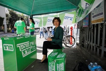 Meretz head Tamar Zandberg at a party campaign stall in Tel Aviv on election day. April 9, 2019