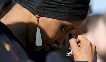 """Rep. Ilhan Omar (D-MN) pauses in thought while participating in a news conference by members of the U.S. Congress """"to announce legislation to repeal President Trump's existing executive order blocking travel from majority Muslim countries"""" outside the U.S. Capitol in Washington, U.S., April 10, 2019"""