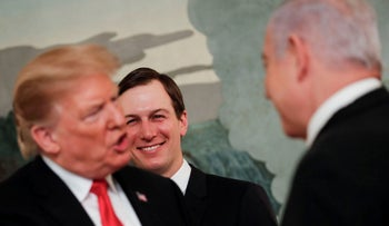 File photo: White House senior adviser Jared Kushner smiles as he watches U.S. President Donald Trump talk with Israel's Prime Minister Benjamin Netanyahu at the White House, March 25, 2019.