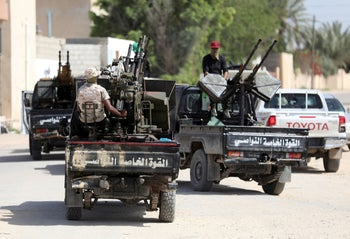 Members of Libyan internationally recognised pro-government forces are seen in military vehicles on the outskirts of Tripoli, Libya April 10, 2019.