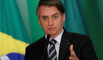 Brazil's President Jair Bolsonaro speaks at the Planalto Palace in Brasilia, Brazil, April 9, 2019.