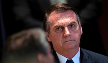 Brazilian President Jair Bolsonaro attends a meeting with evangelical leaders at the Hilton Barra Hotel in Rio de Janeiro on April 11, 2019.