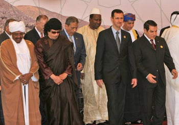 File photo: Front, from left, Sudanese President Omar Al-Bashir, Libyan leader Muammar Gadhafi, Syrian President Bashar Assad, Tunisian President Zine El Abidine Ben Ali, stand during the opening session of the Arab Summit, March 29, 2008.
