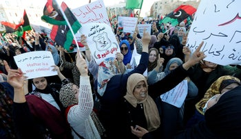 Libyan protesters attend a demonstration to demand an end to the Khalifa Haftar's offensive against Tripoli, in Martyrs Square in central Tripoli, Libya, April 12, 2019.