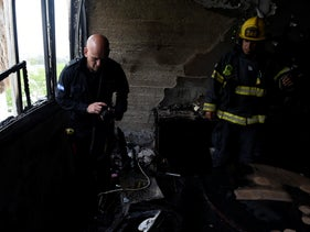 Rescue services put out a fire in an apartment building in Haifa, Israel, April 15, 2019.