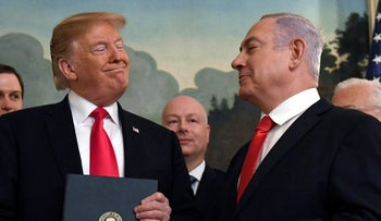 File photo: President Donald Trump smiles at Israeli Prime Minister Benjamin Netanyahu after signing a proclamation at the White House in Washington, March 25, 2019.