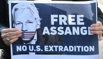 Placard calling for freedom for WikiLeaks founder Julian Assange held by a protestor at Belmarsh Prison in London, where Assange on remand awaiting sentencing for breaching 2012 bail conditions. April 15, 2019