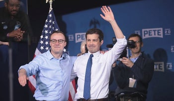 Chasten Glezman (L) joins his husband South Bend Mayor Pete Buttigieg on stage after Buttigieg announced that he will be seeking the Democratic nomination for president during a rally in the old Studebaker car factory on April 14, 2019 in South Bend, Indiana