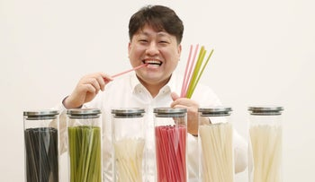 Kwangpil Kim, CEO of Yeonjigonji, an alternative straw maker, holds the world's first edible straws made of rice and tapioca in his office in Seoul, South Korea