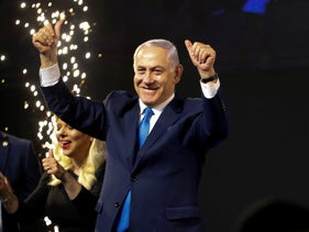 Prime Minister Benjamin Netanyahu waves to his supporters after polls for Israel's Knesset elections closed in Tel Aviv, April 10, 2019.