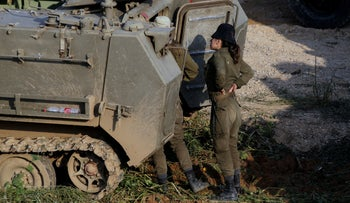 Female IDF soldiers in an armored vehicle lot on the Gaza border, March 2019.