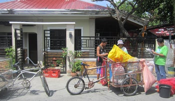 Residents in the City of San Fernando, Pampanga take part in the implementation of the city's solid waste management program.