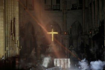 Smoke is seen in the interior of Notre Dame cathedral in Paris, April 15, 2019.