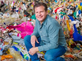 """Jack """"Tato"""" Bigio, CEO and founder of UBQ, sitting by unsorted garbage that the company will convert into plastic and construction materials"""
