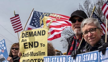 People gather as the Minnesota chapter of the Council on American-Islamic Relations (CAIR-MN) joins a coalition of community organizations in support of Minnesota Representative Ilhan Omar, outside the Nuss Truck and Equipment in Burnsville, Minnesota where US President Donald Trump spoke on April 15, 2019.