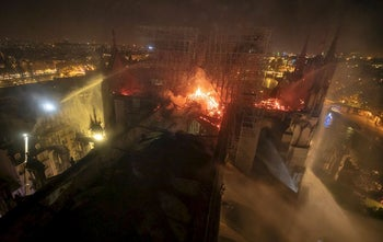 This aerial photo provided Tuesday April 16, 2019 by the Paris Fire Brigade shows Notre Dame cathedral burning, Monday April 15, 2019