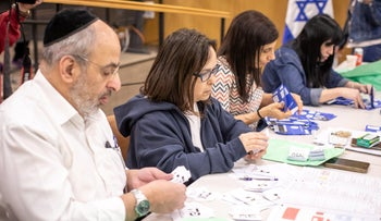Central Elections Committee workers count votes after Israel's election, April 2019.