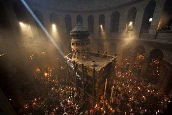 Christian pilgrims hold candles at the Church of the Holy Sepulchre, traditionally believed to be the burial site of Jesus Christ, during the ceremony of the Holy Fire in Jerusalem's Old City, April 14, 2012.