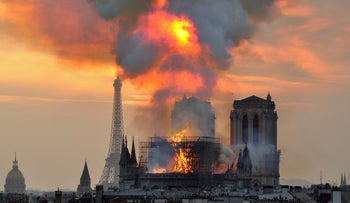 Flames and smoke rise from the blaze at Notre Dame cathedral in Paris, Monday, April 15, 2019