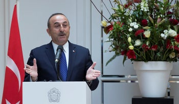 Turkey's Foreign Minister Mevlut Cavusoglu gestures during a press conference in Amsterdam, Netherlands, Thursday, April 11, 2019.