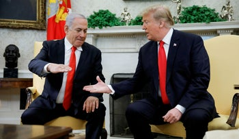 File photo: Israel's Prime Minister Benjamin Netanyahu shakes hands with U.S. President Donald Trump during their meeting in the Oval Office at the White House in Washington, March 25, 2019.