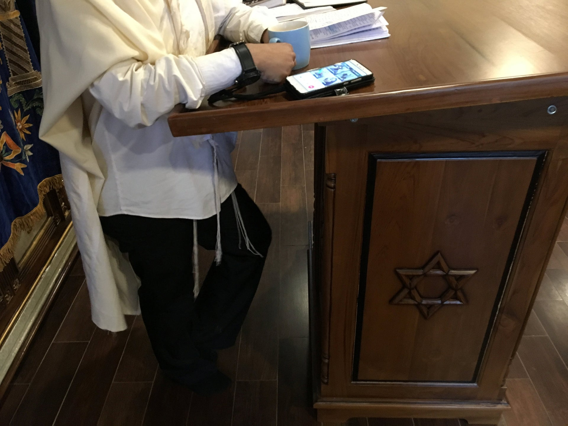 Although electronics are not permitted during Shabbat, Rabbi Benjamin Meijer Verbrugge uses Line's video-conferencing application to allow people from across the Indonesian archipelago and East Timor to participate in the service.
