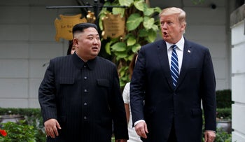 Trump and Kim Jong Un take a walk after their first meeting at the Sofitel Legend Metropole Hanoi hotel, in Hanoi, on February 28, 2019.