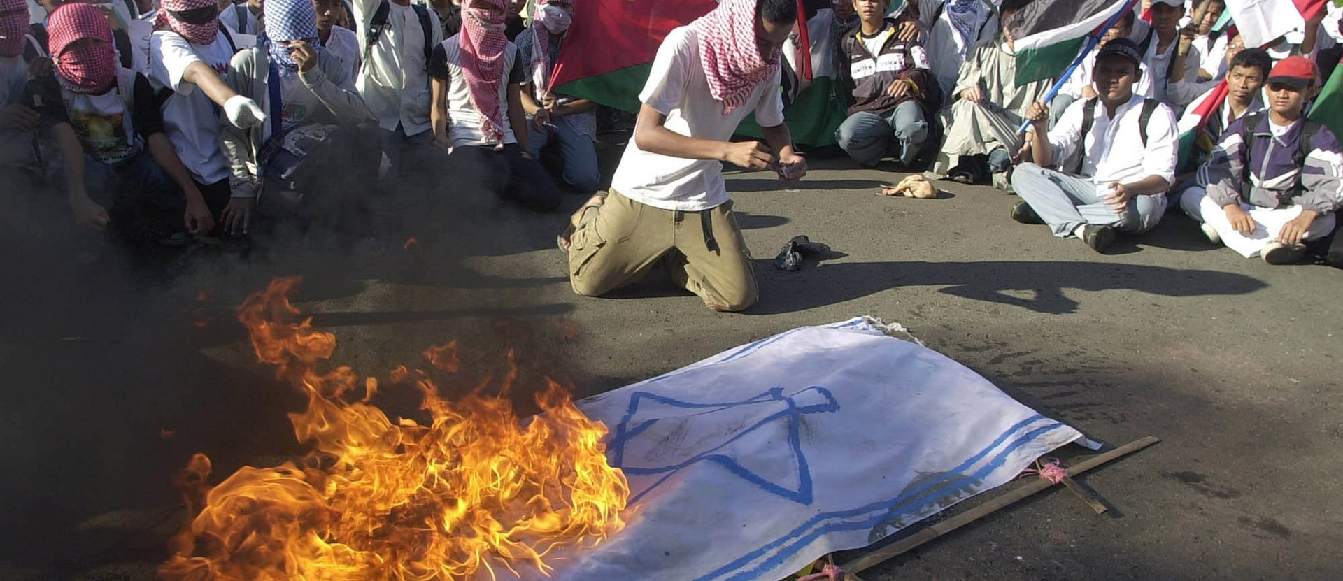 FILE: Indonesian Muslim protesters burn the Israeli flag during an anti-Israel protest in Jakarta, Indonesia