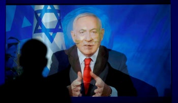 File photo: A monitor transitions from a still image to a video satellite feed from Israel of Prime Minister Benjamin Netanyahu addressing AIPAC in Washington, U.S., March 26, 2019.