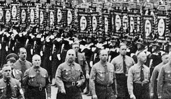 In this 1938 file photo Heinrich Himmler, second right, chief of secret police and Dr. Wilhelm Frick, right, and other leading members of the Nazi party march along Koenigliche Platz in Munich, southern Germany