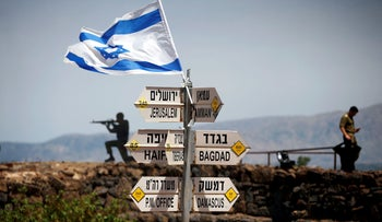 File photo: An Israeli soldier stands on Mount Bental, an observation point in the Golan Heights that overlooks the Syrian side of the Quneitra crossing, Israel, May 10, 2018.