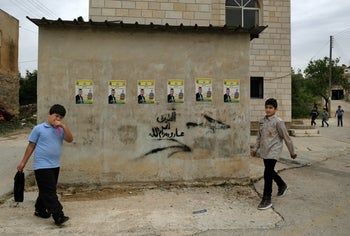 The village of Khirbet Qeis, with photos of Mohammed Abdel Fattah on the wall.