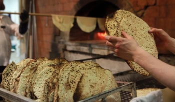 Ultra-Orthodox Jews in Israel preparing shmura matza, a special type of the traditional Passover staple, April 2016.