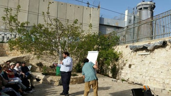 Tariq Zoughbi lecturing to a group from Sweden in Wi'am center in Bethlehem, West Bank.