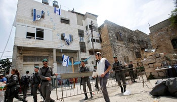Israeli border police officers are seen in front of a building in the West Bank city of Hebron, July 26, 2017.